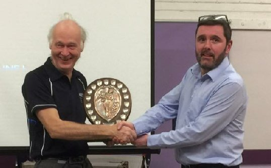 Ian Reed accepts his trophy from Simon Sumner